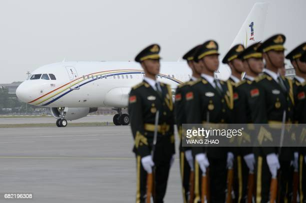 The plane carrying Malaysian Prime Minister Najib Razak lands at Beijing Capital International Airport on May 12,2017. Najib Razak arrived to take...