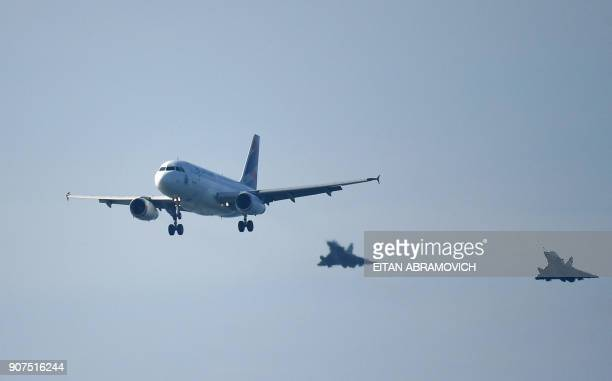 The plane carrying Pope Francis is escorted shortly before landing at the beach resort town of Huanchaco northwest of the Peruvian city of Trujillo...
