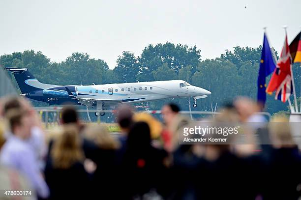 The plane carrying Queen Elizabeth II and Prince Philip Duke of Edinburgh arrives at the military airport of Celle on June 26 2015 in Celle Germany...