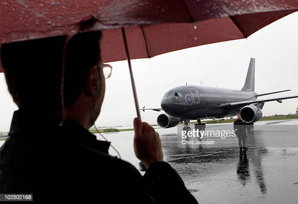 The plane carrying Queen Elizabeth II and Prince Philip Duke of Edinburgh arrive in torrential rain at Robert L Stanfield International Airport on...