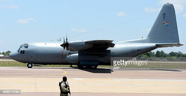 The plane carrying the coffin of South African former president Nelson Mandela on December 14 2013 proceeds to take off from Waterkloof air force...