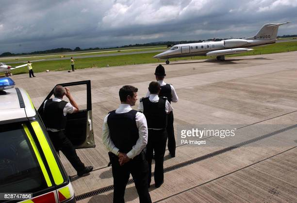 The plane carying John Barber from Spain after his extradition on drug dealing charges arrives at Manchester Airport to be met by Police...