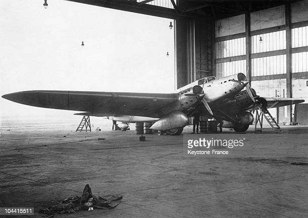 The plane of Jean MERMOZ a threeengined 650HPW Couzinet ARC EN CIEL in a hangar at the Bourget around 19311932