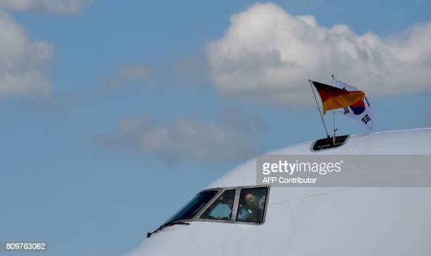 TOPSHOT The plane of South Korea's President Moon Jaein arrives at the airport in Hamburg northern Germany on July 6 2017 Leaders of the world's top...