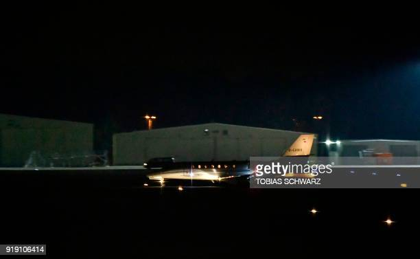 The plane with allegedly GermanTurkish journalist Deniz Yucel on board lands in Berlin on February 16 2018 Turkey has released Deniz Yucel from...