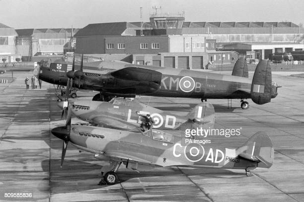 "The planes of the Royal Air Force's famous ""Battle of Britain Memorial Flight"" sit on the runway at RAF Coltishall. The planes a Spitfire, Hurricane..."