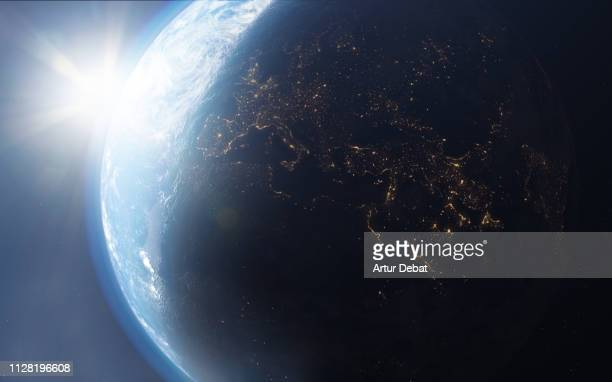 the planet earth taken from the outer space with bright sun. - europa continente foto e immagini stock