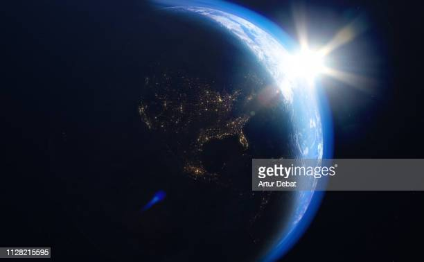 the planet earth taken from the outer space with bright sun. - solar system stock pictures, royalty-free photos & images