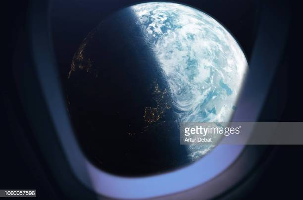 the planet earth taken from the spaceship window during outer space trip. - spaceship stock pictures, royalty-free photos & images