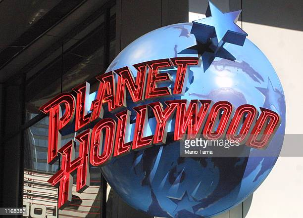 The Planet Hollywood logo is displayed above the Times Square restaurant October 24, 2001 in New York City. Planet Hollywood International Inc. Filed...