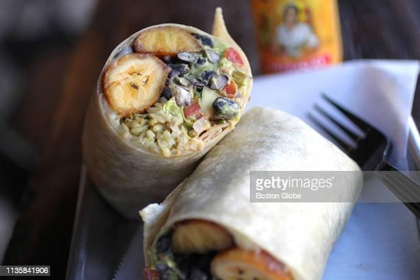 The plantain burrito is pictured at Los Amigos Taqueria in Davis Square in Somerville MA on April 2 2019