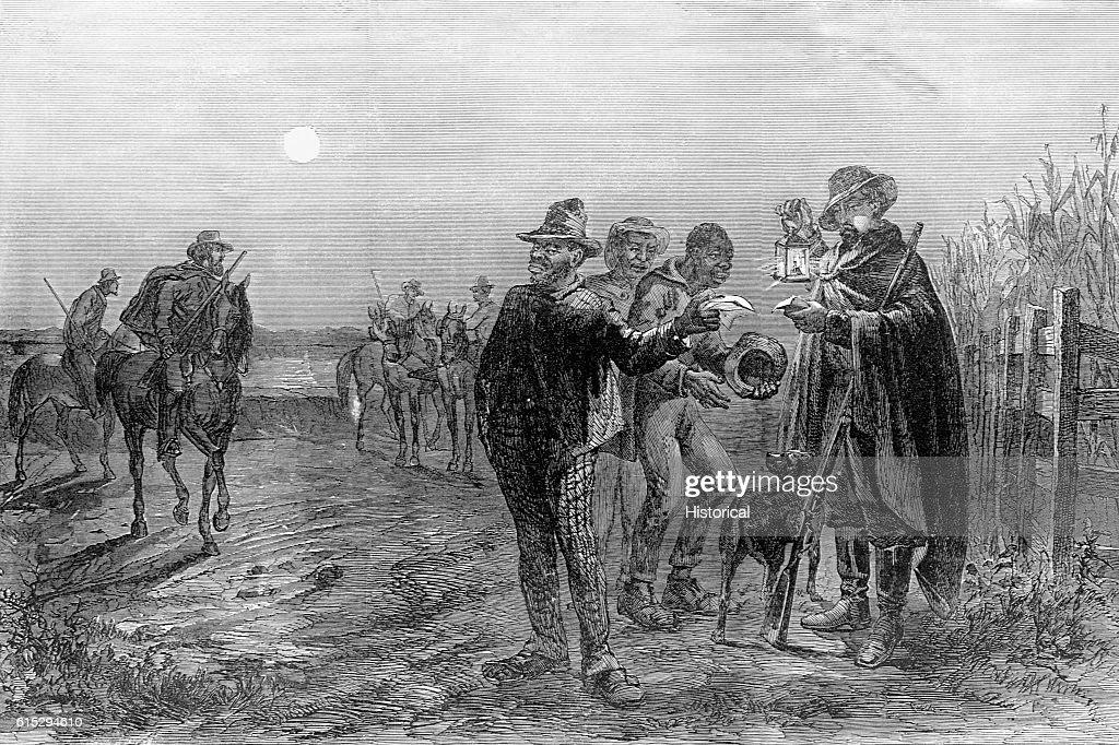 Patrolman Looking Over Enslaved People Passes : Nachrichtenfoto