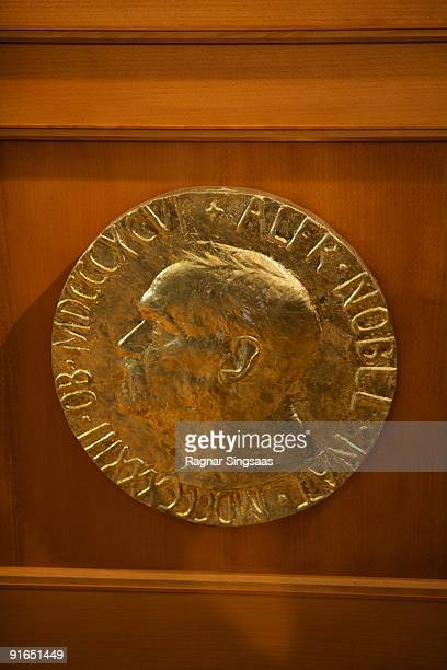 The plaque is displayed as Norwegian Nobel Committee Head Thorbjoern Jagland announces Barack Obama as the recipient of the Nobel Peace Prize on...