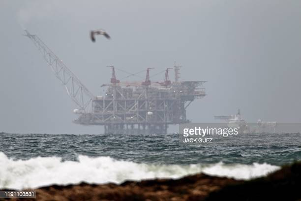 The platform of the Leviathan natural gas field in the Mediterranean Sea which started production today is pictured from the Israeli northern coastal...
