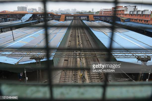 The platforms and tracks of the New Delhi Railway Station are seen deserted in New Delhi on May 11 2020 One of the world's largest train networks...