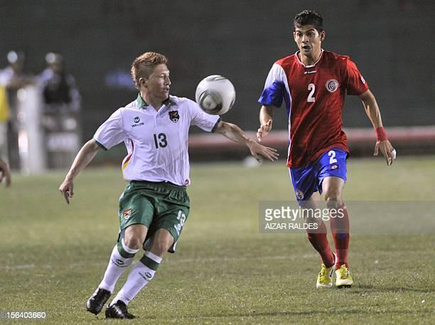 The player Cristian Gamboa de Costa Rica mark facing Alejandro Chumacero of Bolivia during a friendly match played Ramon Aguilera stadium in the city...