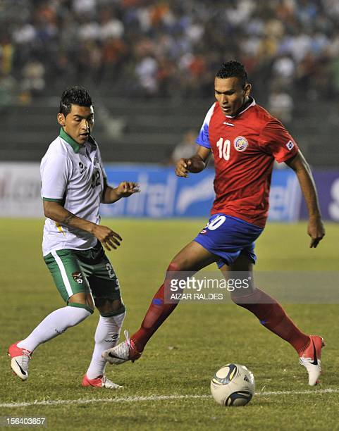 The player Cristian Lagos de Costa Rica mark facing Ruddy Cardozo of Bolivia during a friendly match played Ramon Aguilera stadium in the city of...