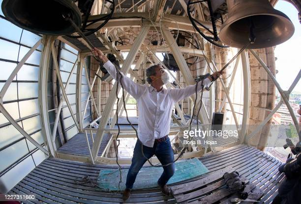 The player grasps the strings and makes the bells ring during the concert on top of the cathedral bell tower on May 23, 2020 in Burgos, Spain. The...