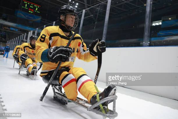 The player leaves the ice rink during a break time in the Para Ice Hockey test event for the Beijing 2022 Winter Olympics at National Indoor Stadium...