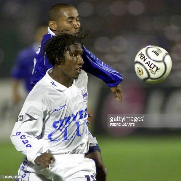 The player of Ecuadorian Emelec Richard Borja fights for a ball with the player of Colombian Millionairos Carlos Castro during the semifinal game of...