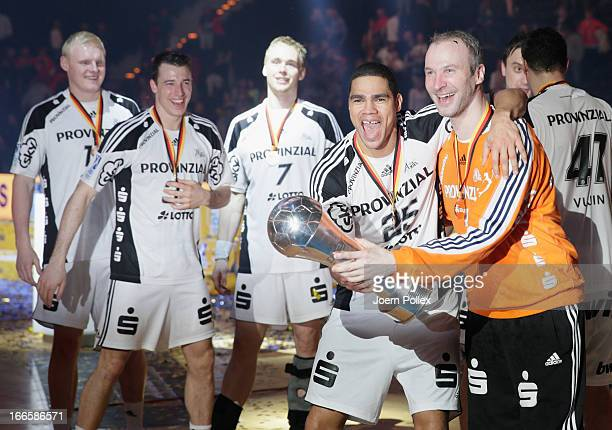 The player of Kiel celebrate with the cup after winning the Lufthansa Final Four Final between THW Kiel and SG FlensburgHandewitt at O2 World on...