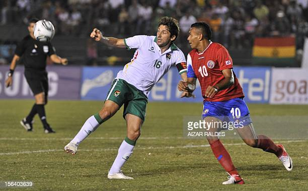 The player Ronal Raldes of Bolivia mark facing Cristian Lagos Costa Rica during a friendly match played at the stadium Ramon Aguilera city of Santa...