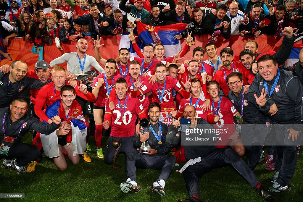 The players and coaches of Serbia celebrate beating Brazil to win the FIFA U-20 World Cup after the FIFA U-20 World Cup Final match between Brazil and Serbia at North Harbour Stadium on June 20, 2015 in Auckland, New Zealand.