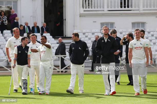 The players and coaching staff of Nottinghamshire CCC walk out for a team photograph during the Nottinghamshire CCC Photocall at Trent Bridge on...