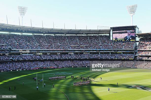 The players and crowd stand for a minutes silence in tribute to Anzac Day during the round five AFL match between the Collingwood Magpies and the...