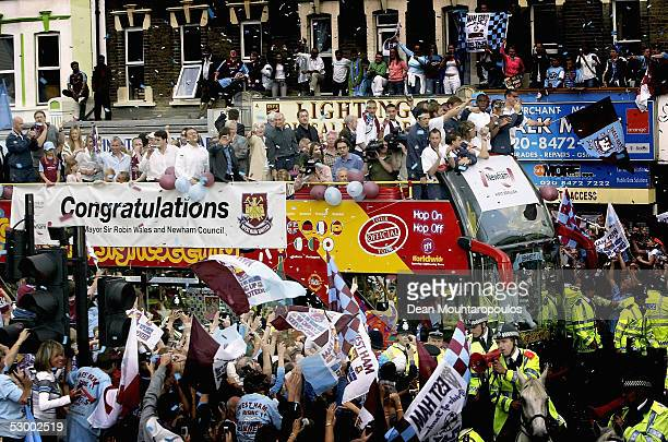 The players and fans celebrate as the team bus drives down Barking Road towards Upton Park Stadium during the West Ham United playoff final victory...