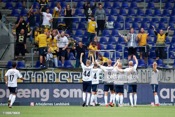 The players and fans of AC Horsens celebrate the selfgoal from Paulus Arajuuri of Brondby IF during the Danish 3F Superliga match between Brondby IF...