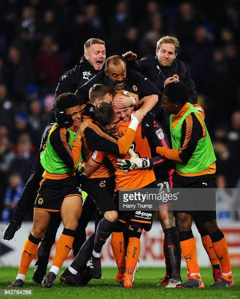 The players and Nuno Espirito Santo Manager of Wolverhampton Wanderers celebrate with keeper John Ruddy of Wolverhampton Wanderers after he saves two...