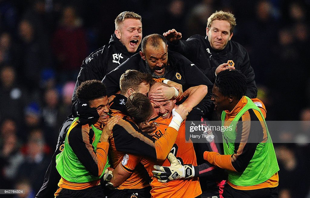 The players and Nuno Espirito Santo, Manager of Wolverhampton Wanderers(C) celebrate with keeper John Ruddy of Wolverhampton Wanderers after he saves two penalities in injury time to win the game during the Sky Bet Championship match between Cardiff City and Wolverhampton Wanderers at the Cardiff City Stadium on April 6, 2018 in Cardiff, Wales.