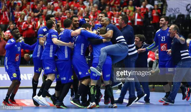 The players and officials of France celebrate winning at the end during the 26th IHF Men's World Championship 3rd place match between Germany and...