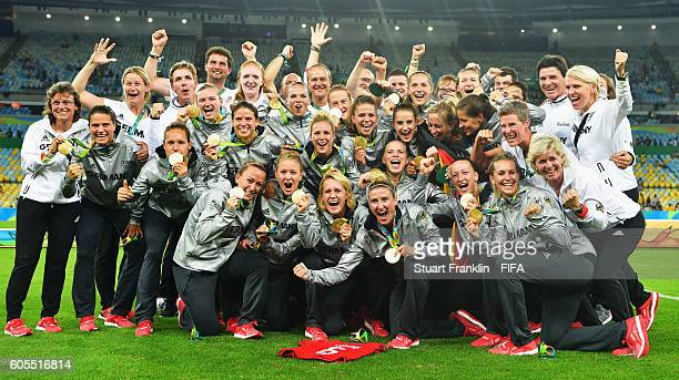 The players and officials of Geemany celebrate winning the Olympic Women's Football final between Sweden and Germany at Maracana Stadium on August 19...