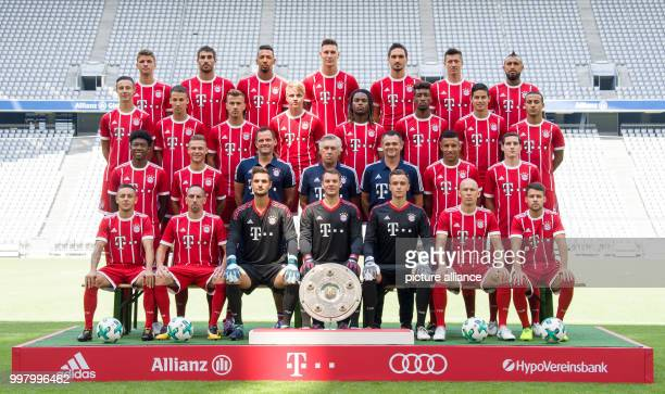 The players and senior staff of the FC Bayern Munich team pose for an official photograph in Munich Germany 8 August 2017 Top row LR Thomas Müller...