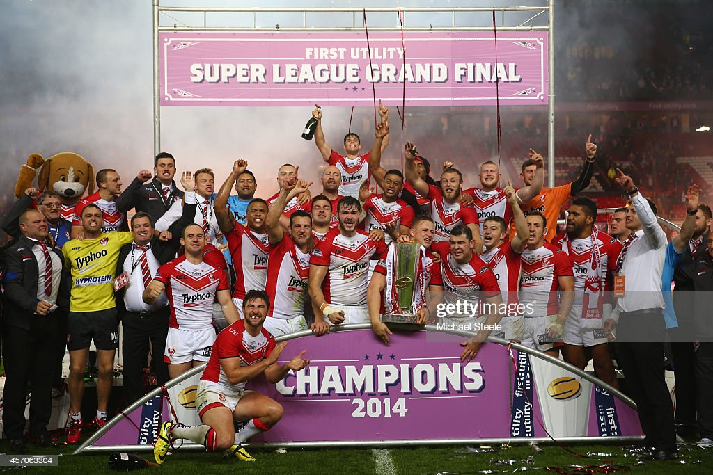 The players and staff of St Helens celebrate their 14-6 victory during the First Utility Super League Grand Final match between St Helens and Wigan Warriors at Old Trafford on October 11, 2014 in Manchester, England.