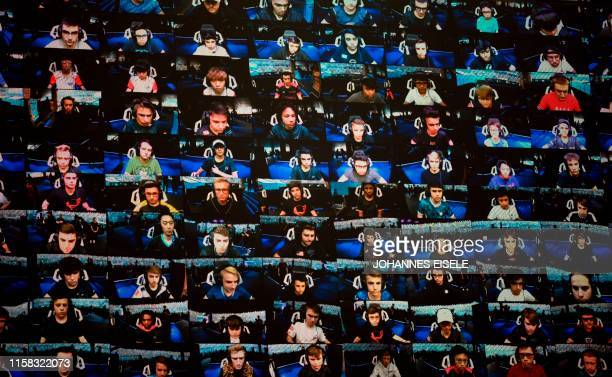 The players are seen on a TV screen during the final of the Solo competition at the 2019 Fortnite World Cup July 28 2019 inside of Arthur Ashe...
