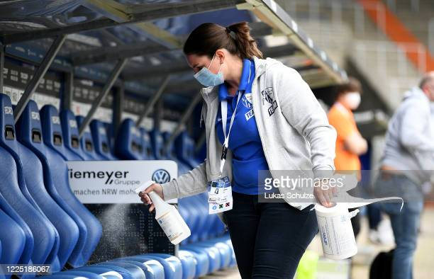 The players bench is desinfected before the Second Bundesliga match between VfL Bochum 1848 and 1. FC Heidenheim 1846 at Vonovia Ruhrstadion on May...