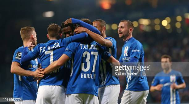 The Players celebrate after scoring during the 3 Liga match between Hansa Rostock and Eintracht Braunschweig at Ostseestadion on March 09 2020 in...