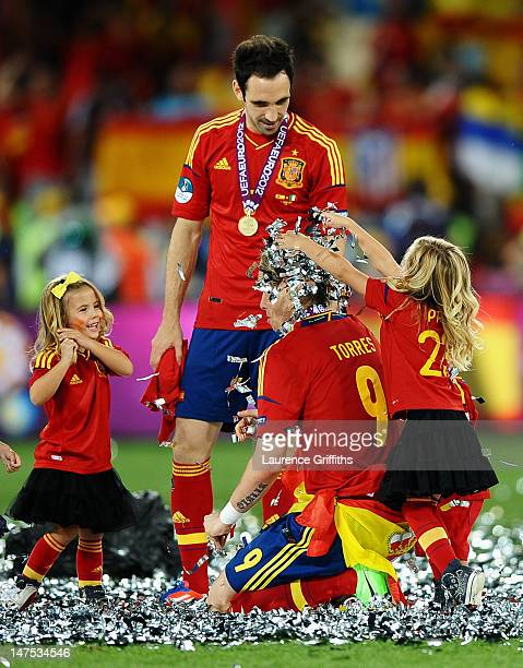 The players' children play in the confetti with Fernando Torres and Juanfran of Spain during the UEFA EURO 2012 final match between Spain and Italy...