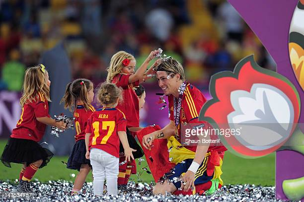 The players' children play in the confetti with Fernando Torres during the UEFA EURO 2012 final match between Spain and Italy at the Olympic Stadium...