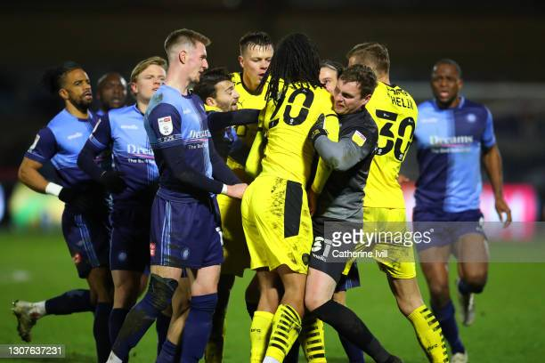 The players clash as tempers flare after a challenge between Toby Sibbick of Barnsley FC and Joe Jacobson of Wycombe Wanderers during the Sky Bet...