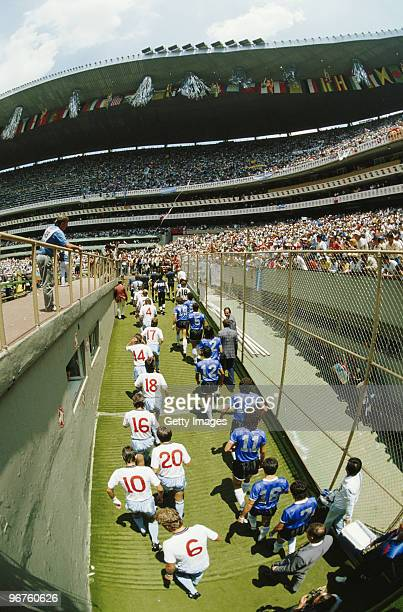 The players from Argentina and England walk onto the pitch during the 1986 FIFA World Cup Quarter Final on 22 June 1986 at the Azteca Stadium in...
