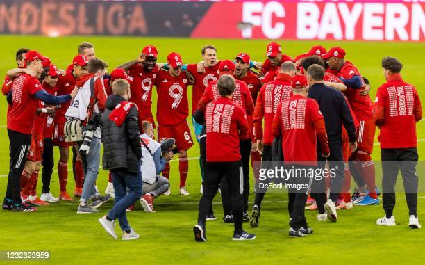 The players from Bayern Muenchen celebrate the championship the Bundesliga match between FC Bayern Muenchen and Borussia Moenchengladbach at Allianz...