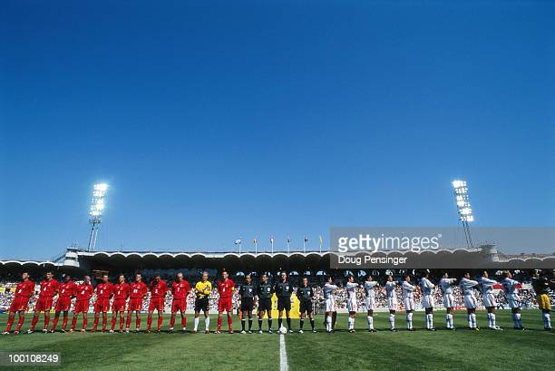 The players from Belgium and Mexico line up for their respective national anthems before their Group E match of the 1998 FIFA World Cup on 20 June...