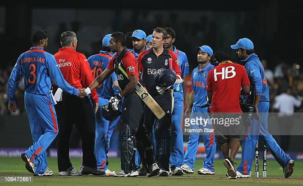 The players from both teams shake hands as the match ends a tie during the 2011 ICC World Cup Group B match between India and England at M....