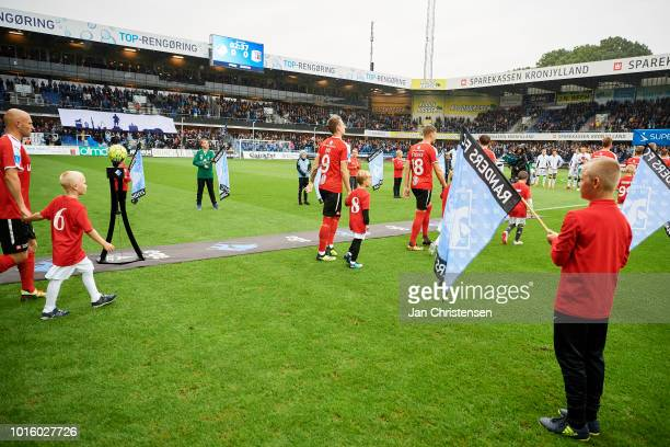 The players from Randers FC walk on to the pitch prior to the Danish Superliga match between Randers FC and AGF Arhus at BioNutria Park Randers on...