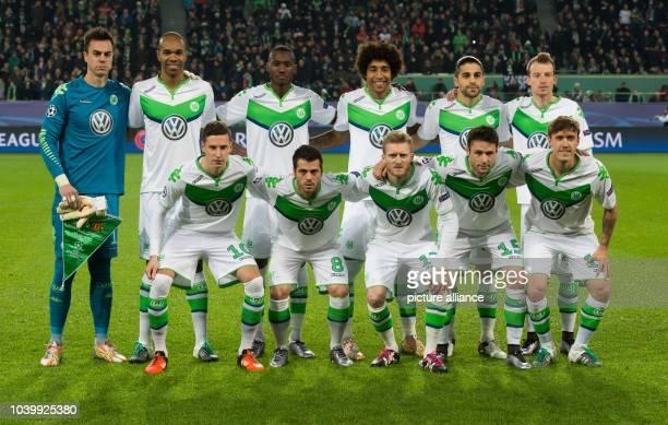 The players from Wolfsburg pose for a group photo with Diego Benaglio Naldo Josuha Guilavogui Dante Ricardo RodriguezMaximilian Arnold Julian...