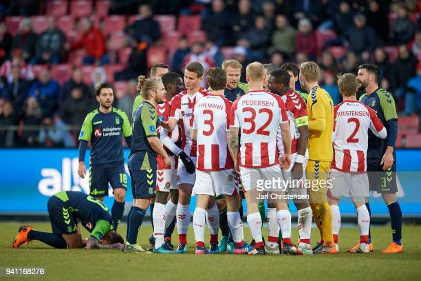 The players in discussion after Jores Okore of AaB Aalborg has injured Jan Kliment of Brondby IF during the Danish Alka Superliga match between AaB...